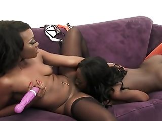 Ebony lesbians Monica Rae and Skyler Nicole pig out on pussy love