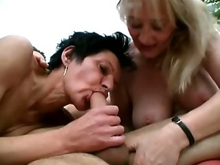 Two mature bitches bow to give a fantastic blowjob together