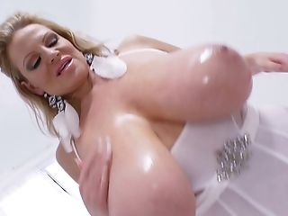 Kelly Madison opens her legs for a hot plowing session with a dildo