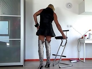 sexy PUTAIN in leather dress and python thigh boots