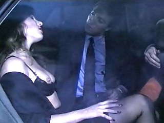 Beautiful classic busty blondie in the car gives head to her man