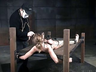 Hot leg tattoo on a chick tied up in the dungeon
