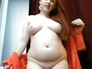 Redhead BBW with big tits is teasing