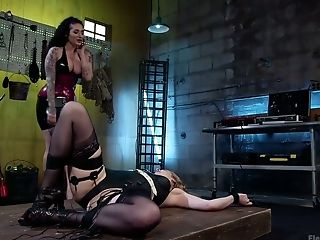 Seductive red haired bitch Ela Darling is punished by one kinky mistress in latex corset