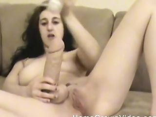 Irresistible brunette chick enjoys drilling her cunt with a dildo