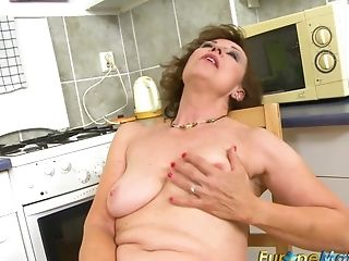 Older mature granny Dana Beranova got so horny while making coffee that she did herself